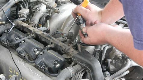 remove replace fuel injector  honda acura youtube