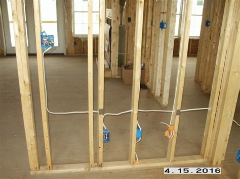 210 new construction switch and outlet boxes mounted and