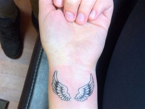 tattoo angel wings on wrist angel wing wrist tattoos pictures posted in wings