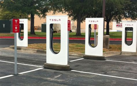 Tesla Car Charging Stations Tesla Taking Steps To Stop From Parking At Charging