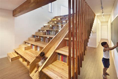 staircase bookshelves bookcase staircase slide boing boing