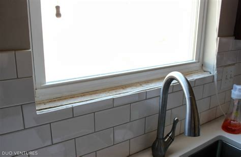 Installing Backsplash Kitchen by Duo Ventures Kitchen Update Paint Touch Ups Window Sill
