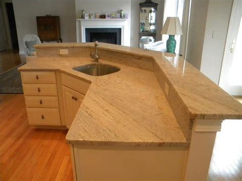 granite countertops for ivory cabinets ivory fantasy granite kitchen countertops the stone cobblers