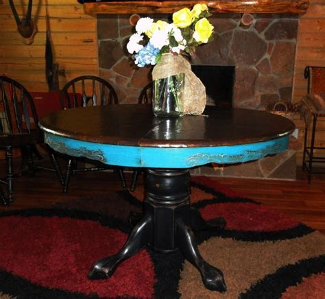 """Round table with """"leather look"""" top painted turquoise"""