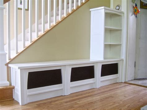 entry bench bookcase stair railing traditional