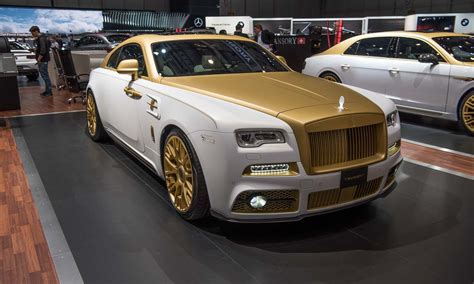 rolls royce gold and red mansory wraith