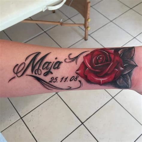 rose script tattoo script and cover up on an on the wrist