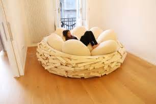birdnest wooden bed filled with soft egg shaped