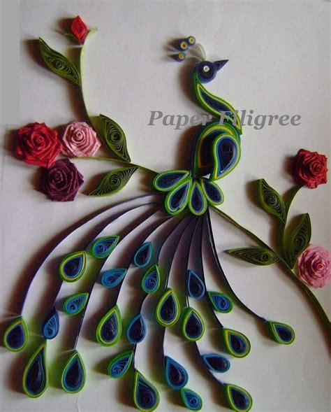 Quilling Paper Craft - an paper quilled peacock is a picture frame which