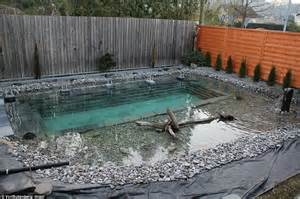 backyard swimming pond swiss family spends 34 000 and one year building