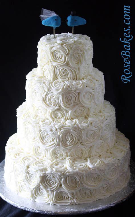 ivory buttercream roses wedding cake  lovebirds cake topper