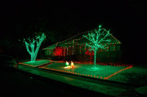 red green and white christmas tree lights holiday decorating contest survey