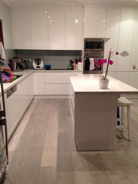 Kitchen Laminate Flooring Our New Kitchen Quickstep Quot Authentic Oak Quot Laminate Flooring White Gloss Polyurethane Cabinetry