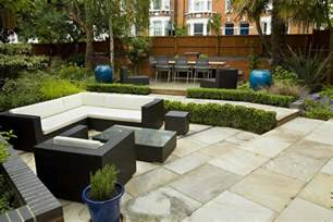 Large paved garden terrace with sunken paved area, and timber decking