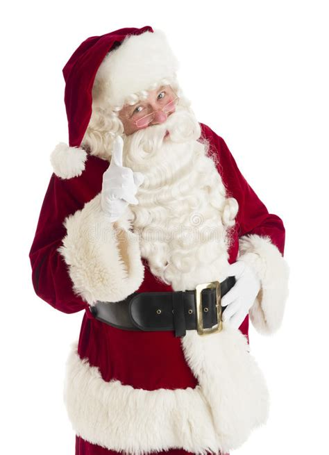 santa claus pointing against white background stock image