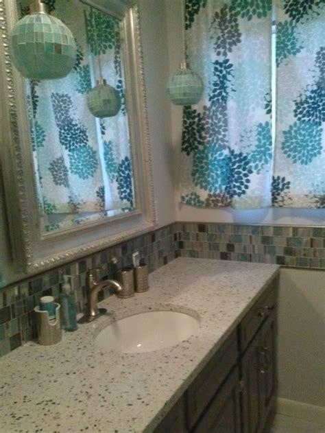 bath in grey and aqua features custom curtains by swirled