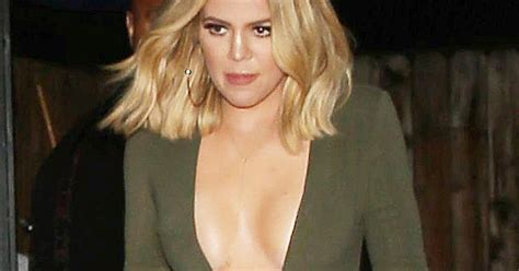 Top Khloe khloe shows chest in insanely low cut skintight top us weekly