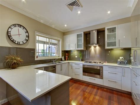 modern u shaped kitchen design using hardwood kitchen