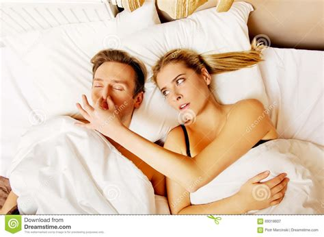 bed man couple in bed man snoring woman can t sleep stock image