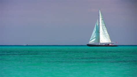 through the water and the a boat sailor s story books a sailboat on the horizon in the beautiful caribbean