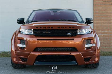 burnt orange range rover vesuvius orange land rover evoque with a hamann widebody