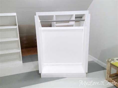 Small Bedroom Makeover slanted wall built ins with hidden storage my love 2 create