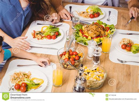 parents child family healthy food at dining table stock