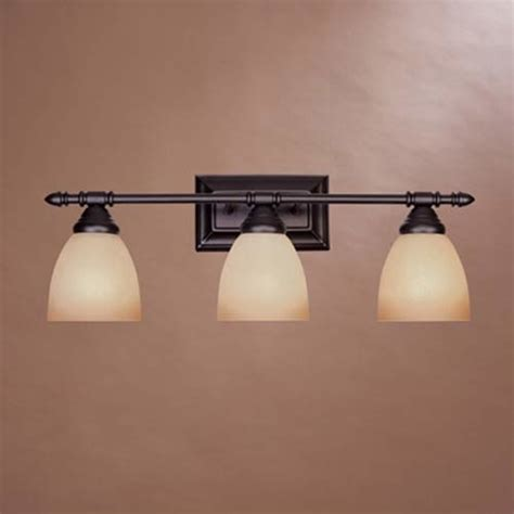 traditional bathroom light fixtures apollo oil rubbed bronze three light bath fixture