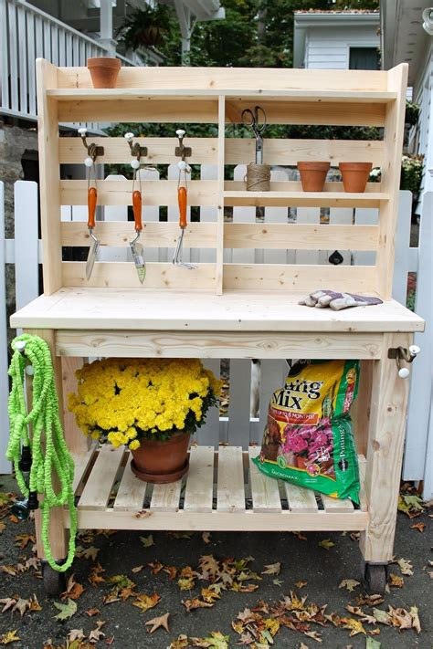 how to build a simple potting bench simple potting bench i like the hooks and shelves home