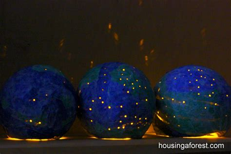 earth globes that light up paper mache light up globes housing a forest