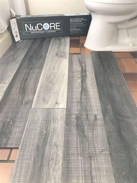 vinyl laminat bad vinyl plank flooring that s waterproof lays right on top