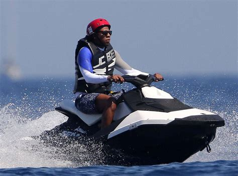 jayz waterscooter beyonc 233 goes jet skiing in a floor length jumpsuit plus