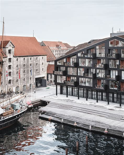 old harbor housing project cobe vilhelm lauritzen mimics existing warehouses in copenhagen housing project