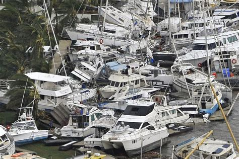 damaged catamaran for sale australia boats piled on top of each other at the port hinchinbrook