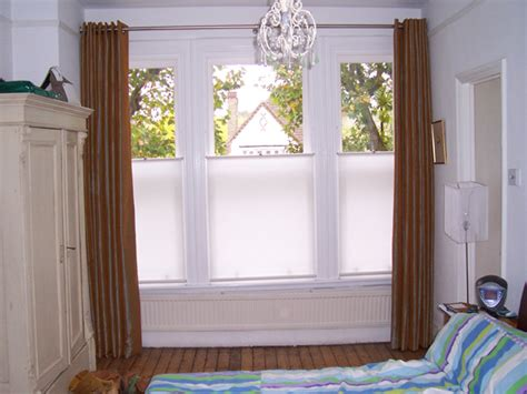 Privacy Blinds Uk artificial silk curtains eyeletted on a pole with bottom