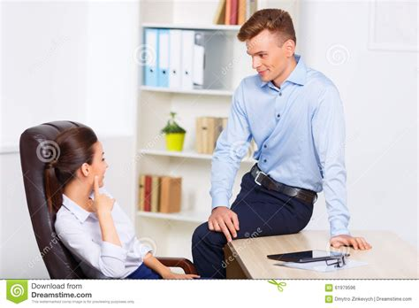 Office Assistant by Office Assistant Flirting With His Stock Photo