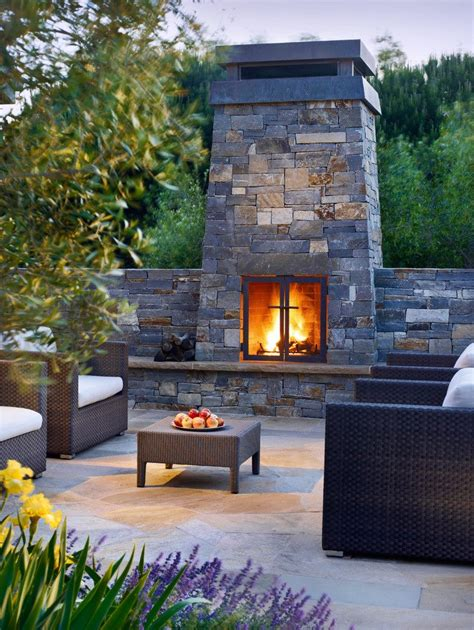 raised fireplace patio contemporary with wall mounted outdoor waterfall fountains