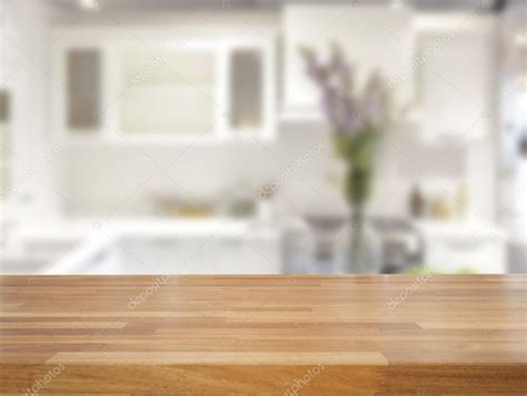 kitchen background empty wooden table and blurred kitchen background stock