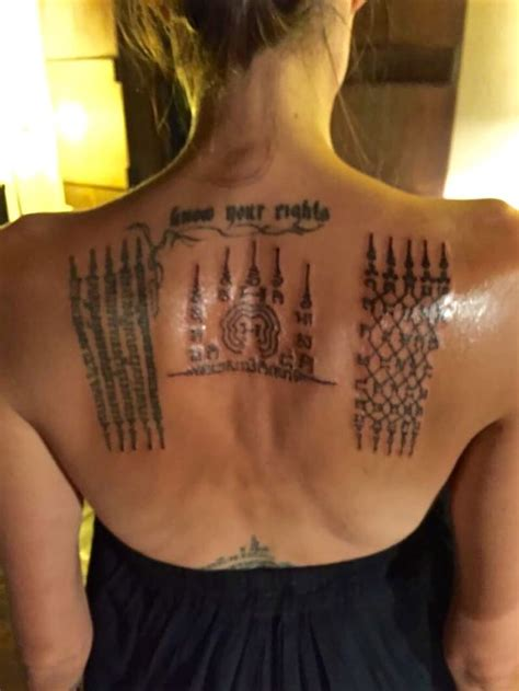 angelina jolie tattoo temple thai monk gives angelina jolie painful tattoos binding
