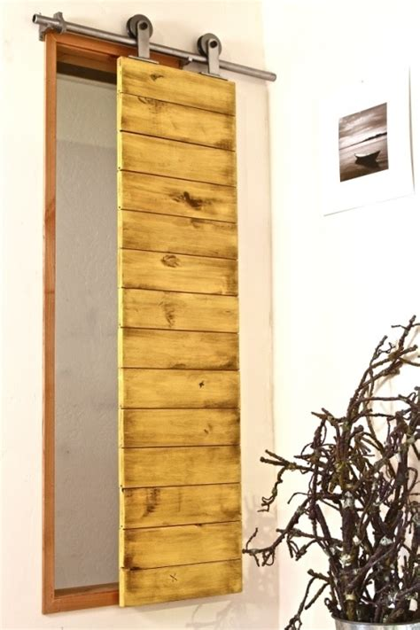 Barn Door Shutters Are An Interesting Way To Cover A Barn Door Window Shutters
