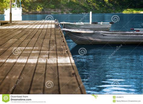 dream of empty boat aluminum fishing boats at wood dock stock photos image