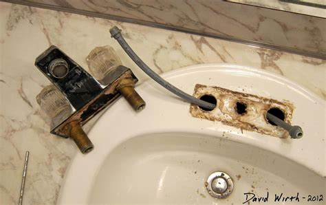 bathroom sink install a faucet