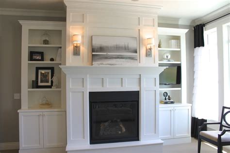 around fireplace living room large white wooden bookcase with brick fireplace four shelves and