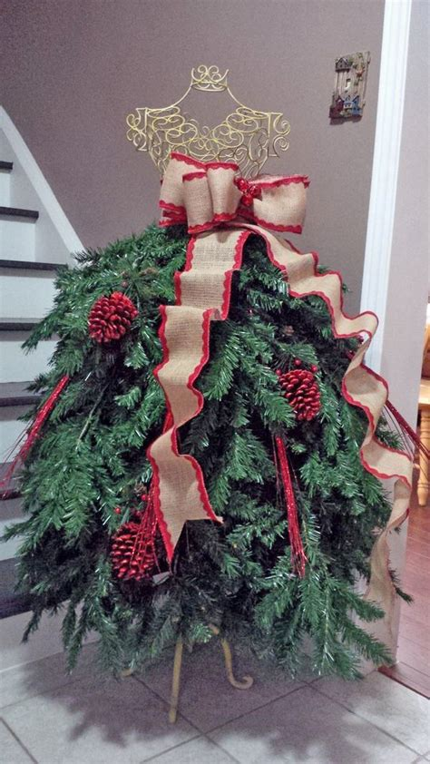 best way to dress a christmas tree she attaches tree branches to the dress form what it becomes this is stunning