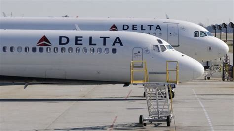 delta airlines worker arrested in gun smuggling plot in