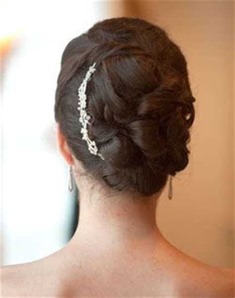 gorgeous pinned curls updo with rhinestone hair brooch
