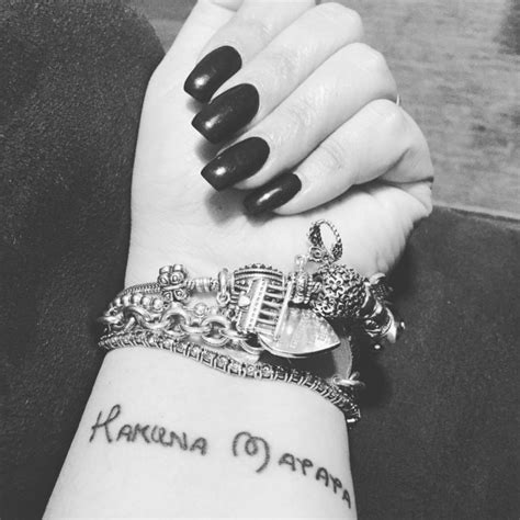 hakuna matata tattoo wrist 40 inspiring hakuna matata symbol tattoos its meaning