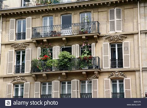 apartment with balcony paris apartment building balcony with flowers stock photo