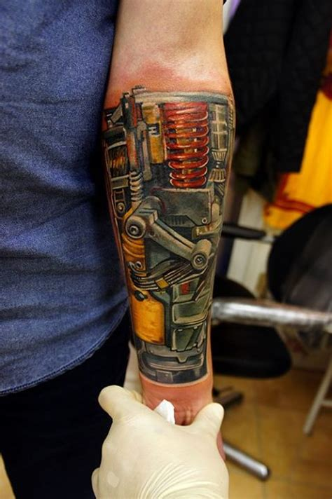 incredible biomechanical tattoo on forearm