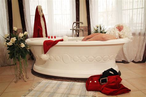 santa claus relaxing in a bath photograph by isabel poulin